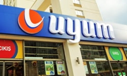 Uyum Market logo